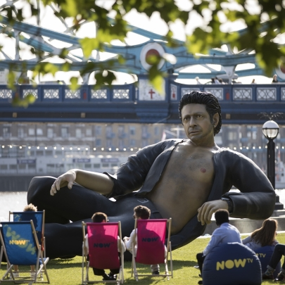 A giant statue of Jeff Goldblum next to London's Tower Bridge celebrates 25 years of Jurassic Park